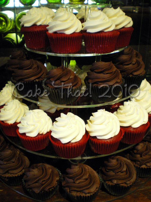 The wedding Red Black and White theme was resonated in this cupcake tower