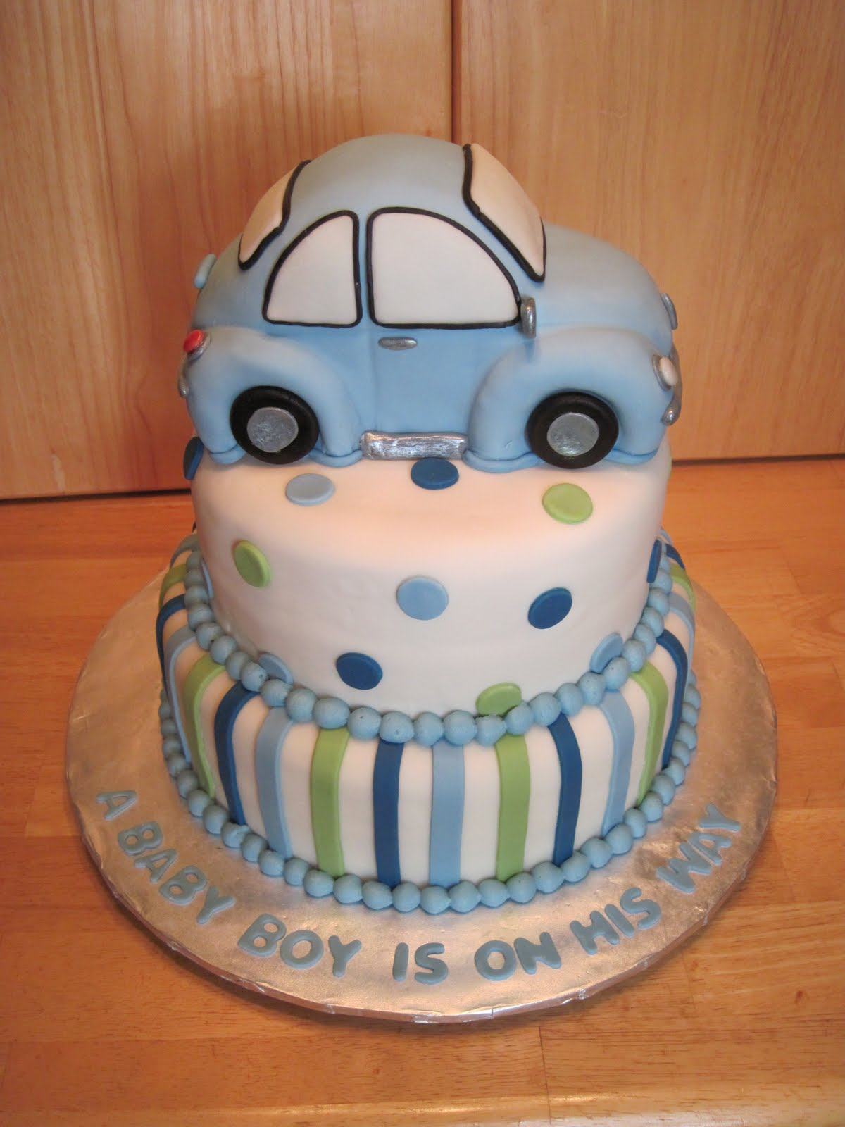 race car baby shower theme is going to save the car for his first