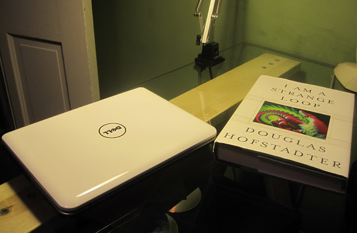 Dell Mini 9 next to an exemplar hardback