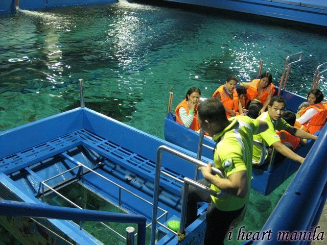 The Manila Ocean Park's glass bottom boat ride. a small boat with a glass