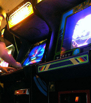 Retro Remakes 2008 Competition. Image of arcade games Berzerk and Centipede glowing brightly.
