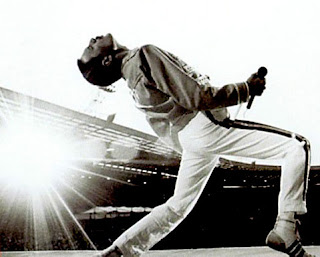 Image of Freddy Mercury playing air-guitar - well sort of.