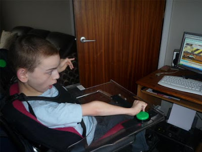 Colin McDonnell playing a web-game using switches and a C-SID switch interface.