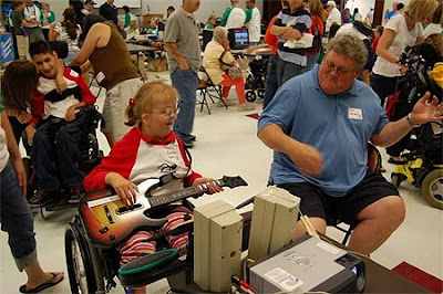 Fantastic photo of a daughter and her Dad playing Guitar Hero at AbleGames 2009.