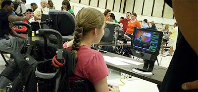 Image of a young woman playing Peggle using Eye Control.