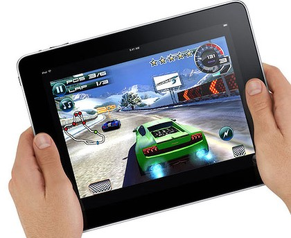 Stock image of an Apple iPad, with a race game playing.