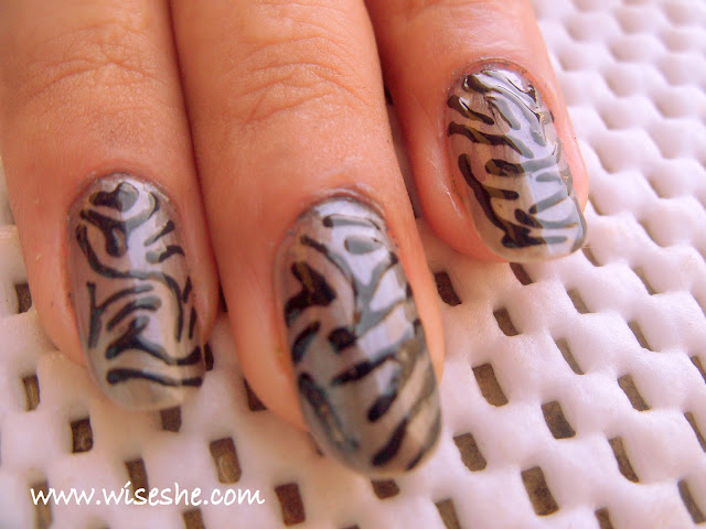 rihanna tiger print nails. how to do animal print nails.