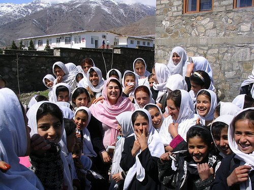 A Panjsheri famale teacher with her students