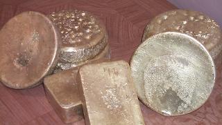 слитки рудного золота
