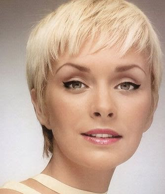 short hair with side bangs and layers. with thinning hair on top.
