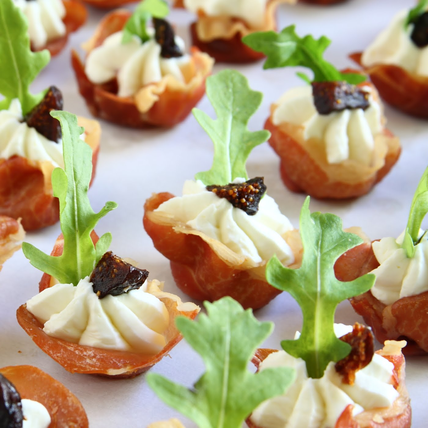 Prosciutto Cups with Goat Cheese Whip, Dried Mission Fig, & Arugula