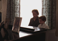 Ned and Joshua playing piano.