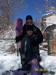 Daddy and the kids sledding