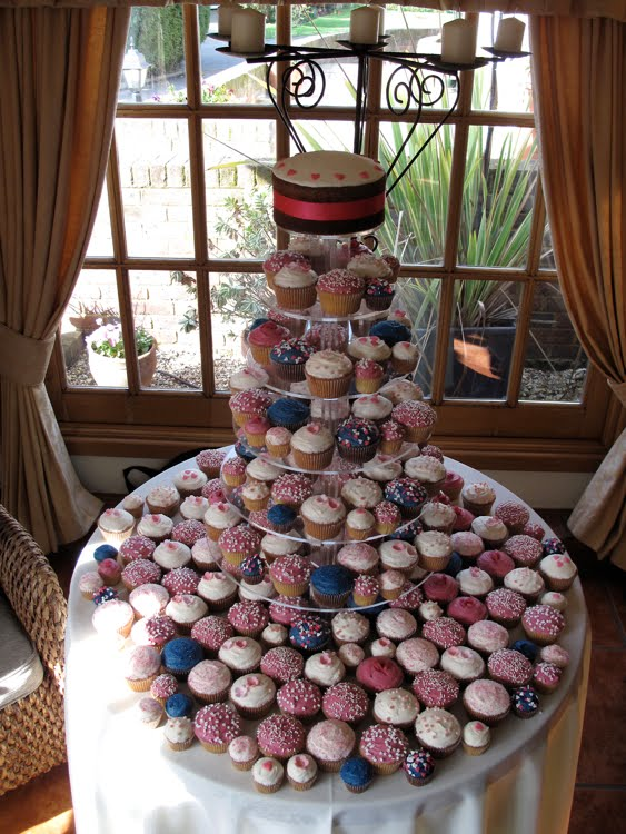 Hot pink and Navy cupcakes Here 39s a wedding tower we did for Anne in a hot