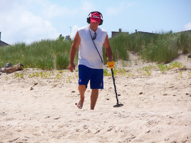 Beach metal detector man - July 2010