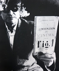 Marcel Broodthaers holding Sadoul's L'Invention du Cinéma