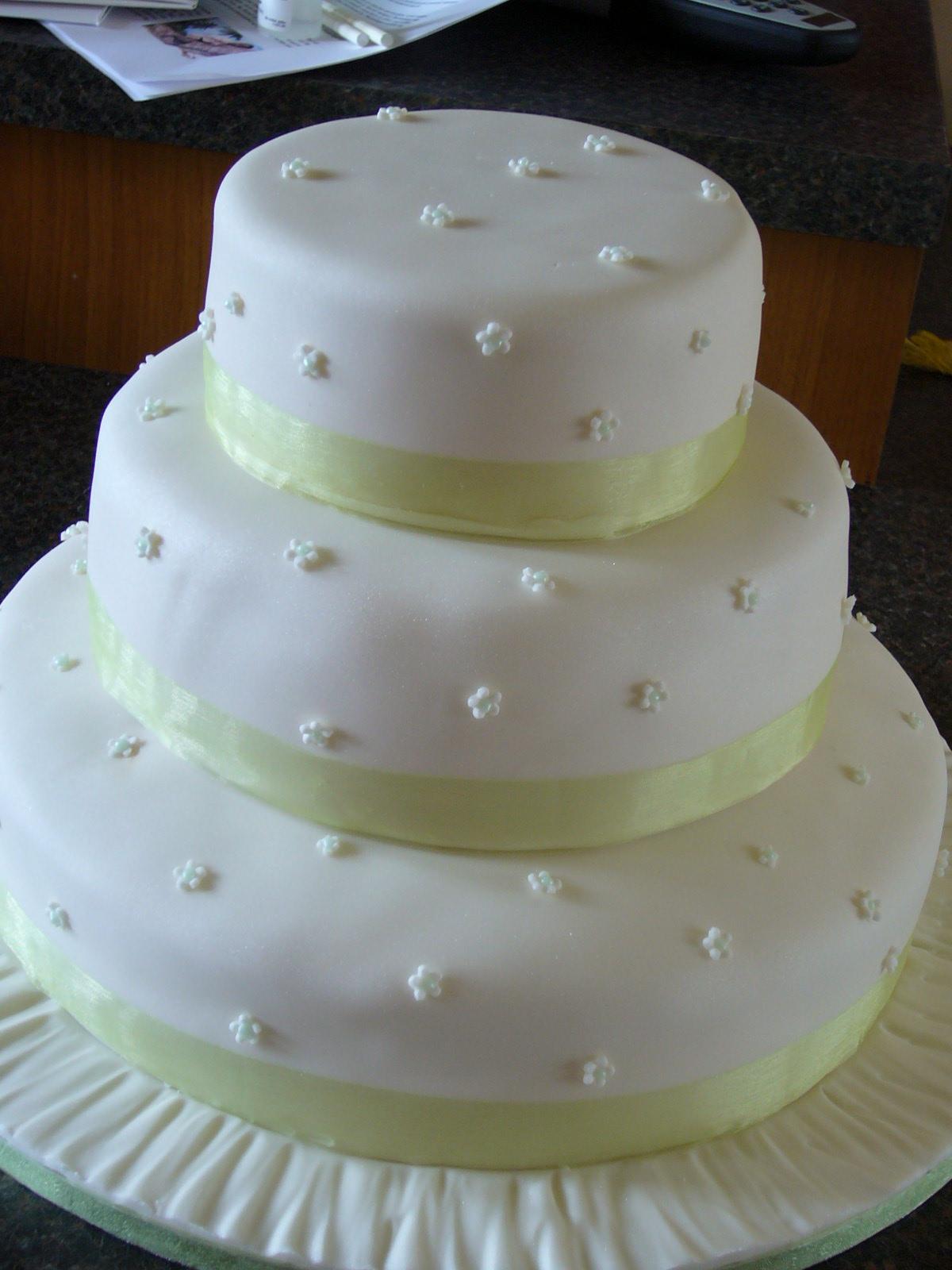 "Wedding cake. 12"" Rich Fruit Cake, 9"" Chocolate Sponge and 6"" ..."