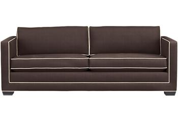 Chocolate brown sofa with white contrast piping from Crate and Barrel