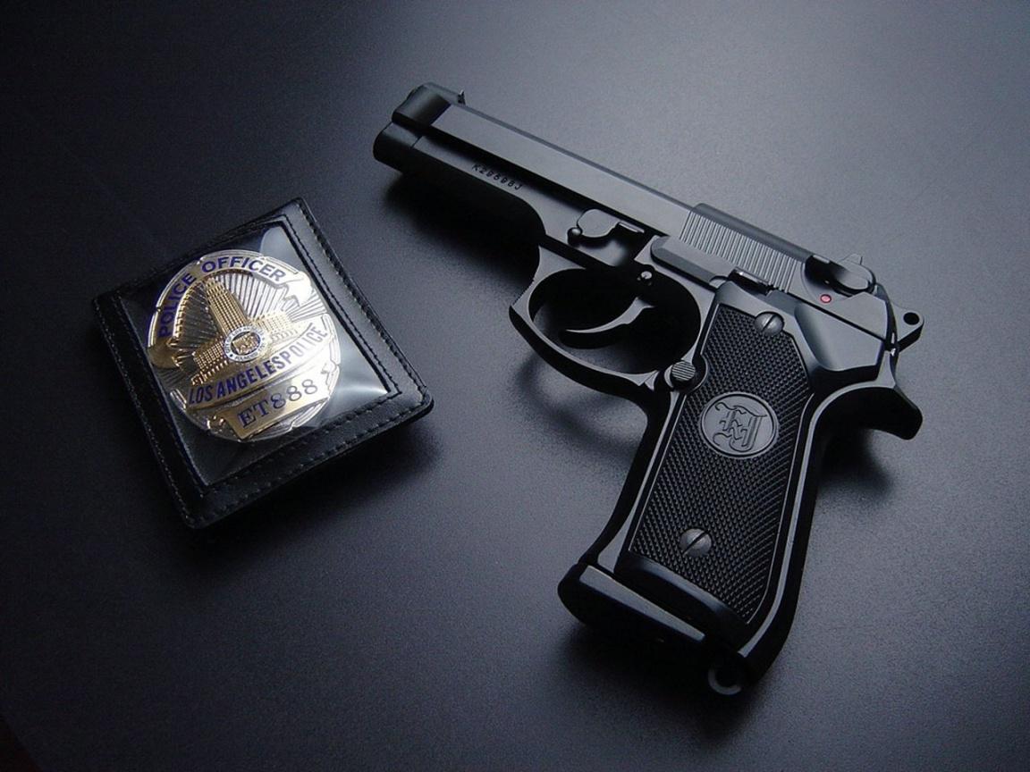 man with gun badge - photo #7