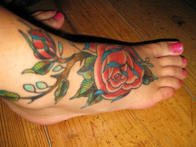 blue rose tattoos. Roses are red, violets are
