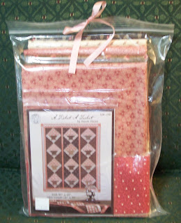 kit of fabrics and pattern for making a basket wallhainging in pinks and browns