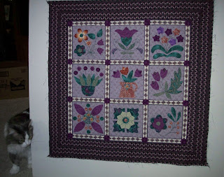 quilt top with nine applique flower blocks