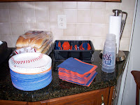 plates, napkins, silverware and cups all orange and blue or with Tigers logo