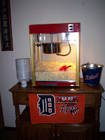 popcorn machine with Tigers towel hanging on bar