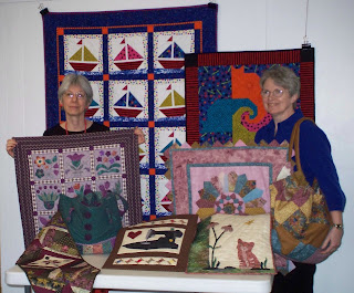 Tam Murphy and Jane Werner display the finished challenge projects