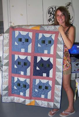 Brandi holding her Kittens quilt