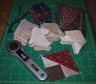 Fabric triangles and squares for mystery quilt