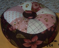 pink and brown patchwork pincushion