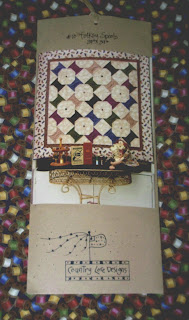 Whirl Into Winter prize - a spools quilt wallhanging and a yard of spools fabric
