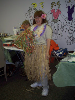 Clara in her grass skirt
