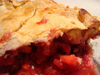 a slice of apple raspberry pie
