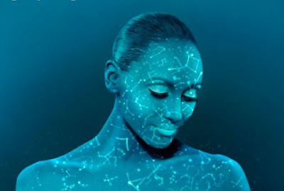 woman painted blue with map of stars
