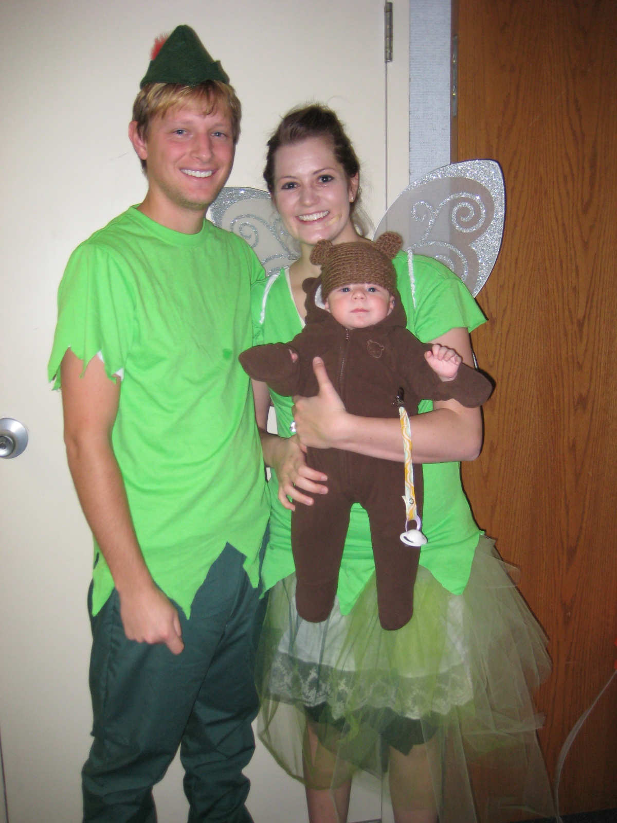 halloween is so fun i love watching the costumes come together im a big fan of group costumes especially when there is a baby involved peter pan