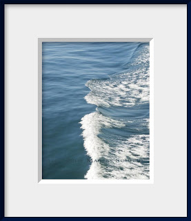 framed photo of ocean blue water rippled and foamed