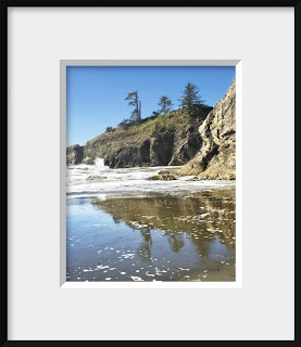framed photo of rocky cliffs, brilliant blue sky and all of the wildness of a Pacific coast