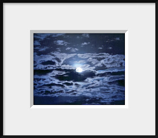 A framed photo of the full moon at twilight is reflected in a cloudy sky and is presented in a monochromatic blue.