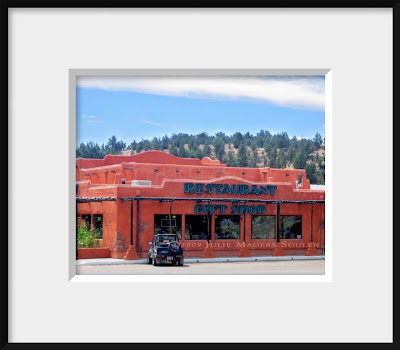 A framed photo of an adobe roadside diner in the American Southwest