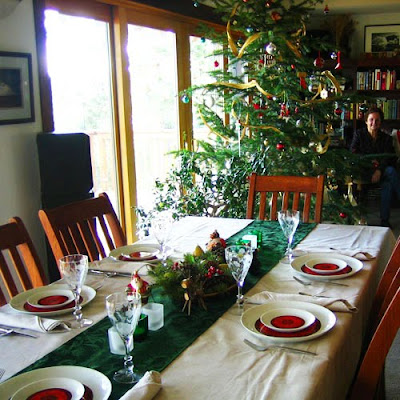 A holiday table is dressed in red and green.