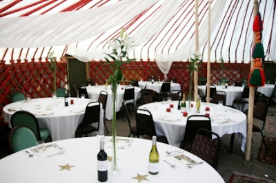 Tables in half of the Yurt