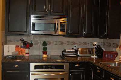 black speckled granite that only made the cabinets look, um, more pink