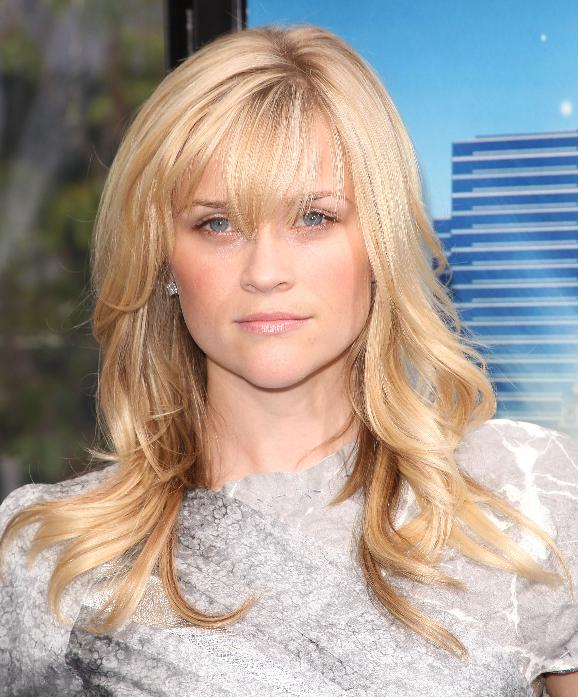 REESE WITHERSPOON's bangs make her look younger and more charming