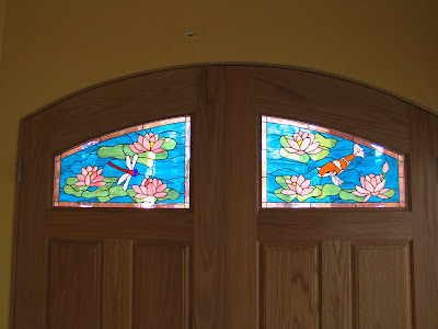 Stained glass craftsmen stained glass koi pond and lotus for Koi pond insert