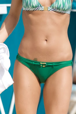 Carrie Underwood in a Green Bikini photo gallery