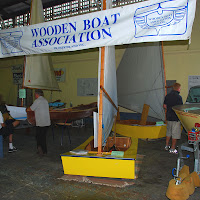 OzRacers and Eureka CAnoe - boats at brisbane working with wood show