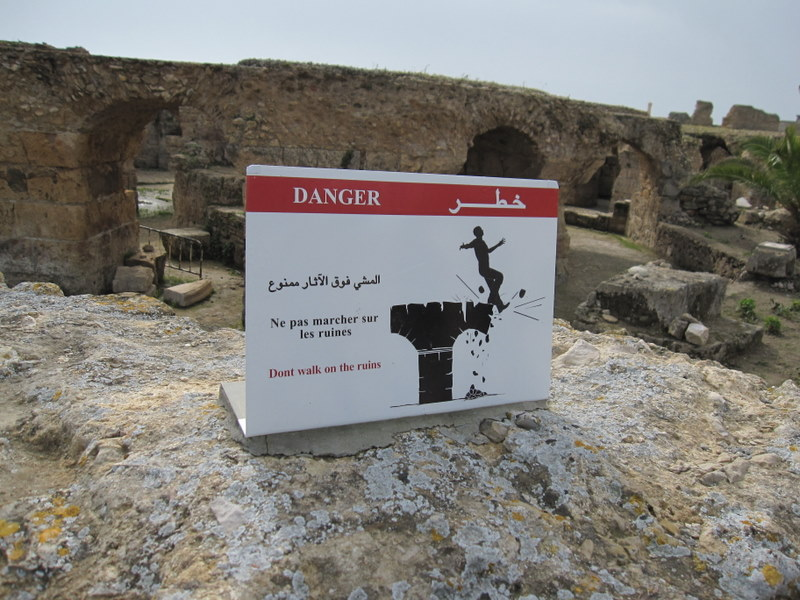 """""""Danger: Do not walk on the ruins"""" with a falling man"""