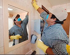 Back To School:  Worker Scrubs School Walls